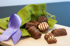 Chocolate. Variety of colorful candy on wooden tray Stock Photos