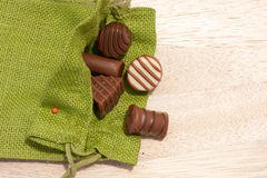 Chocolate. Variety of colorful candy on wooden tray Royalty Free Stock Photography