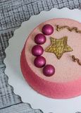 Chocolate velour cake decorated with hemispheres and golden star Royalty Free Stock Images