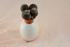 Chocolate velvet cake popsicles in flower vase Stock Image