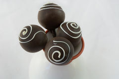 Chocolate velvet cake popsicles in flower vase Royalty Free Stock Image