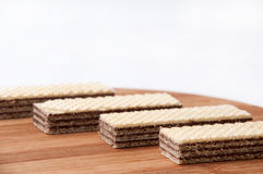 Chocolate wafer on a kitchen wooden board Stock Image