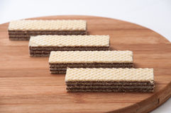 Chocolate wafer on a kitchen wooden board Stock Photography