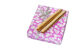 Chocolate wafers on the pink gift box with bow Stock Photos