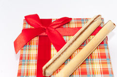 Chocolate wafers with red gift box with bow Royalty Free Stock Images