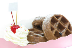 Chocolate waffer with powder sugar and cherry. In the pink box Royalty Free Stock Photo