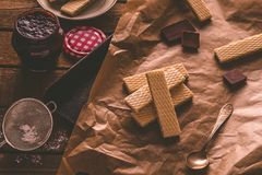 Chocolate waffers on the wooden background Stock Photo