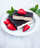 Chocolate waffle cake and strawberrys on the white plate Royalty Free Stock Photos