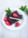 Chocolate waffle cake and strawberrys on the white plate, top vi Royalty Free Stock Photo
