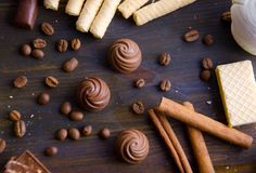 Chocolate waffle coffee beans and cinnamon sticks. Coziness, selective focus Stock Image