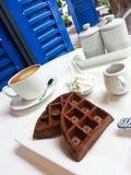 Chocolate waffle with cream. By a cup of coffee Stock Images