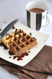 Chocolate Waffle Dish with Cup of Hot Chocolate Stock Photo