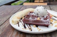 Chocolate waffles with vanilla ice cream, banana, whipped cream Royalty Free Stock Photos