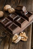 Chocolate and walnuts Stock Photography