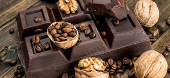 Chocolate and walnuts Stock Photos