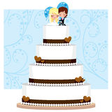 Chocolate Wedding Cake. Chocolate and Cream Wedding Cake with hearts and groom and bride figure on top Royalty Free Stock Photography