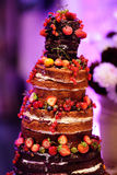 Chocolate wedding cake decorated with fruits Royalty Free Stock Images