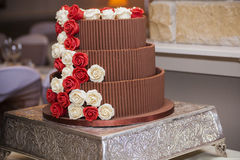 Chocolate wedding cake with roses Royalty Free Stock Photo