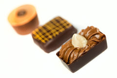 Chocolate on white Stock Images