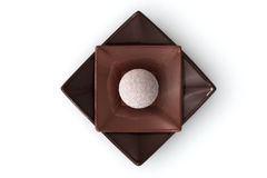 Chocolate on White. Chocolate truffles on a plate isolated over a white background royalty free stock images