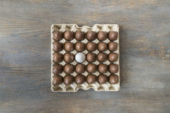 Chocolate and white boiled egg in a recycled paper tray Stock Image
