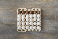 Chocolate and white boiled eggs in a recycled paper tray Royalty Free Stock Photo