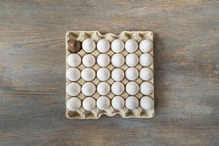 Chocolate and white boiled eggs in a recycled paper tray Stock Image