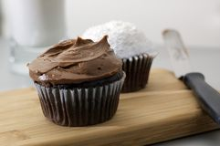 Chocolate and White Cupcakes with Glass of Milk Royalty Free Stock Photos
