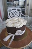 Chocolate whole cake with whipped cream stock images