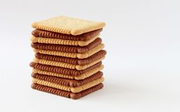 Chocolate and whole grain biscuits. Chocolate and whole grain biscuits on white background Royalty Free Stock Photos