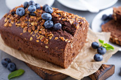 Chocolate whole wheat quick bread. With nuts and fresh blueberry Royalty Free Stock Photos