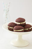Chocolate whoopie pies on cake stand Stock Photo