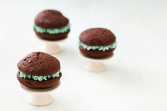 Chocolate whoopie pies on mini cake stands Royalty Free Stock Images