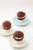 Chocolate whoopie pies on mini cake stands Royalty Free Stock Photography