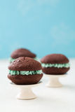 Chocolate whoopie pies on mini cake stands Royalty Free Stock Image