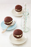 Chocolate whoopie pies on mini cake stands Stock Photos