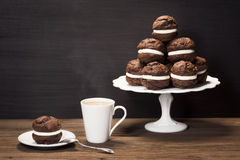 Chocolate Whoopie Pies or Moon Pies with Coffee Stock Photos