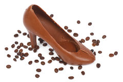 Chocolate Women's shoes and spilled coffee beans Stock Photography