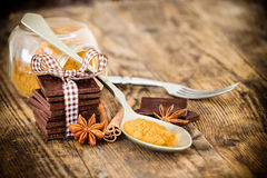 Chocolate wood table surrounded by spices. Stock Photography