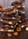Chocolate on a wooden background Royalty Free Stock Image