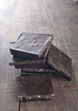 Chocolate on  wooden plank Royalty Free Stock Photography