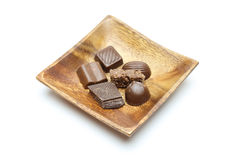 Chocolate in a wooden plate Royalty Free Stock Image
