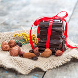 Chocolate on wooden table Stock Photos