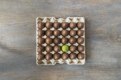 Chocolate wrapped Easter eggs in a recycled paper tray Royalty Free Stock Photos
