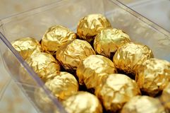 Chocolate wrapped in gold foils Stock Images