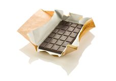 Chocolate in a wrapper. Isolated on white Royalty Free Stock Photos