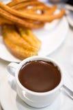 Chocolate y buñuelo Foto de archivo libre de regalías
