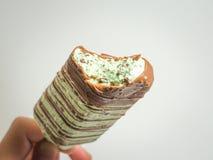 Chocolate y palillo azul del helado de la menta Imagenes de archivo