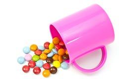 Chocolate y taza coloridos Foto de archivo