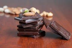 Chocolate y tuercas Imágenes de archivo libres de regalías